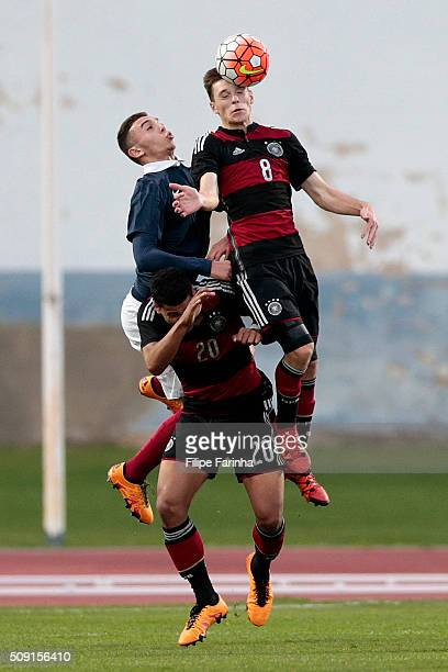 Amine Gouiri of France challenges Adrian Stanilewicz and Noah Awuku of Germany during the UEFA Under16 match between U16 France v U16 Germany on...
