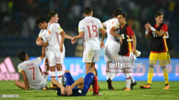 Amine Gouiri of France looks dejected as Spain players celebrate during the FIFA U17 World Cup India 2017 Round of 16 match between France and Spain...