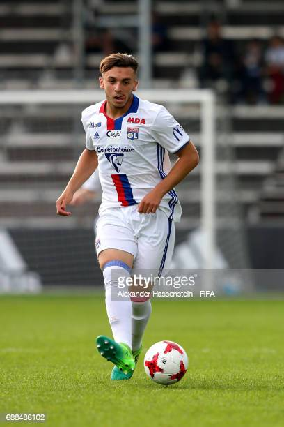 Amine Gouiri of Lyon runs with the ball of St Gallen kicks a corner duirng the 1st round match between West Ham United and Olympique Lyon on day one...