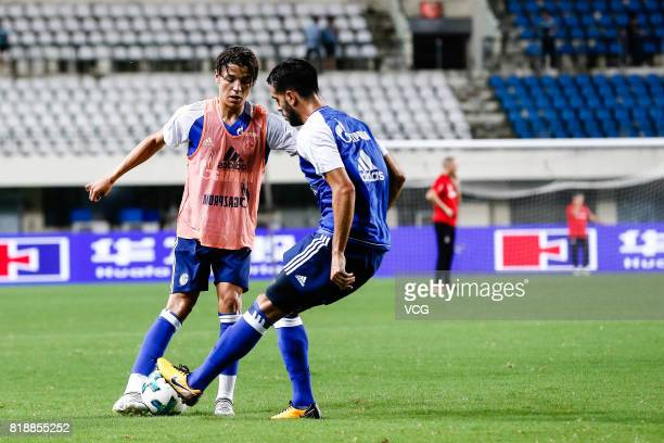 Amine Harit and Pablo Insua of FC Schalke 04 warm up prior to the 2017 International soccer match between Schalke 04 and Besiktas at Zhuhai Sports...