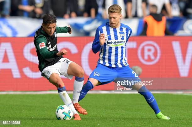 Amine Harit of FC Schalke 04 and Mitchell Weiser of Hertha BSC during the game between Hertha BSC and Schalke 04 on october 14 2017 in Berlin Germany