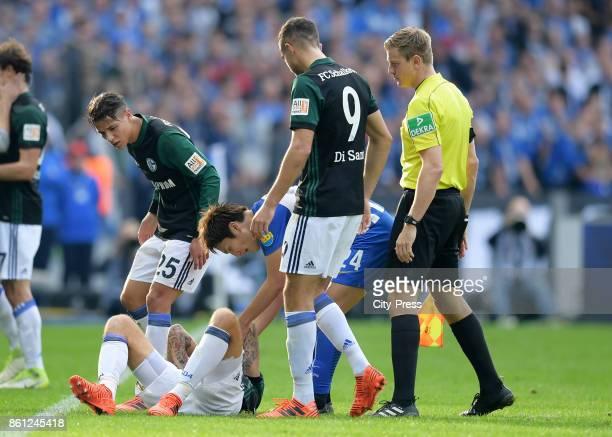 Amine Harit of FC Schalke 04 Guido Burgstaller of FC Schalke 04 Genki Haraguchi of Hertha BSC Franco Di Santo of FC Schalke 04 and linesman Robert...