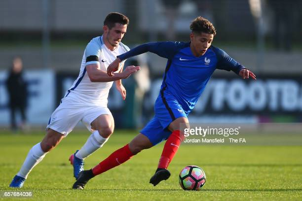 Amine Harit of France is pursued by Lewis Cook of England during the UEFA U20 International Friendly match between France and England at Stade Fred...