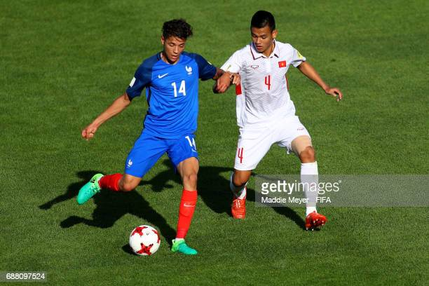 Amine Harit of France makes a pass past Tan Tai Ho of Vietnam during the FIFA U20 World Cup Korea Republic 2017 group E match between France and...