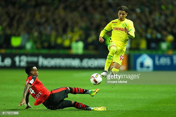 Amine Harit of Nantes and Edson Mexer of Rennes during the Ligue 1 match between FC Nantes and Stade Rennais at Stade de la Beaujoire on October 22...