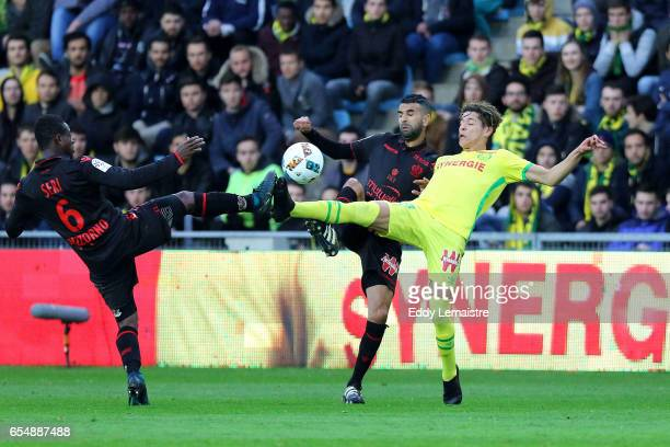 Amine Harit of Nantes and Mounir Obbadi of Nice during the French League match between Nantes and Nice at Stade de la Beaujoire on March 18 2017 in...