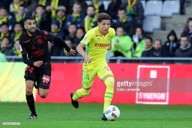 Amine Harit of Nantes and Mounir Obbadi of Nice during the French League match between Fc Nantes and OGC Nice at Stade de la Beaujoire on March 18...