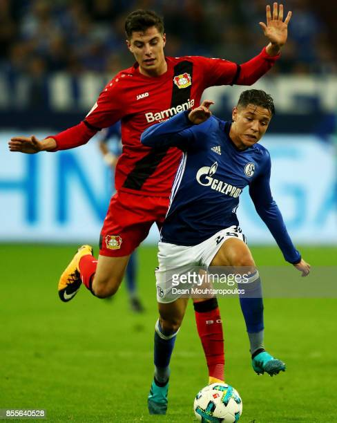 Amine Harit of Schalke 04 gets past the tackle from Kai Havertz of Bayer 04 Leverkusen during the Bundesliga match between FC Schalke 04 and Bayer 04...