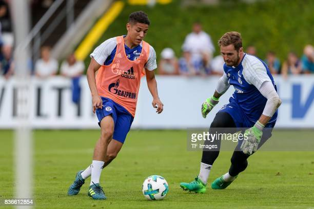 Amine Harit of Schalke and Goalkeeper Ralf Faehrmann of Schalke battle for the ball during the Training Camp of FC Schalke 04 on July 30 2017 in...