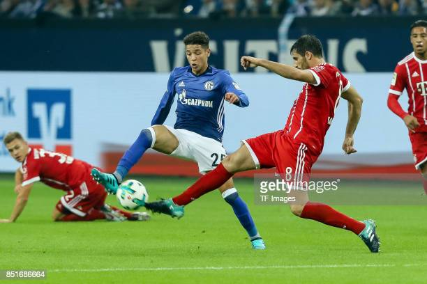 Amine Harit of Schalke and Javier Martinez of Bayern Muenchen battle for the ball during the Bundesliga match between FC Schalke 04 and FC Bayern...