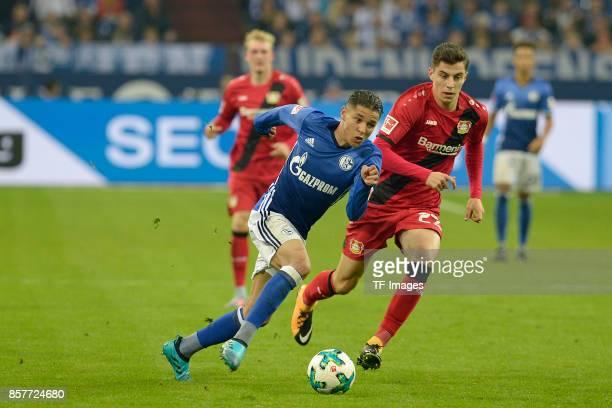 Amine Harit of Schalke and Kai Havertz of Leverkusen battle for the ball during the Bundesliga match between FC Schalke 04 and Bayer 04 Leverkusen at...