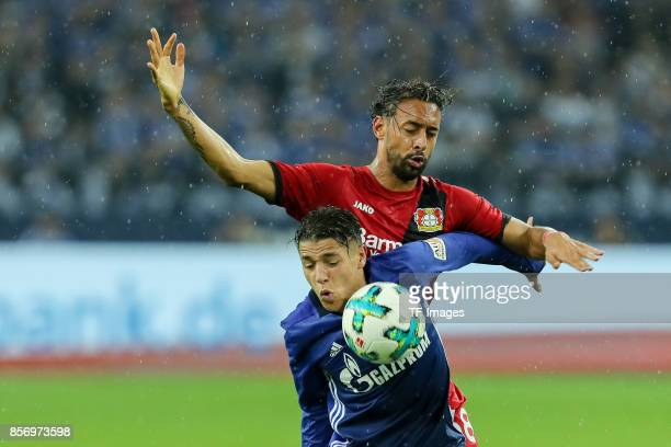 Amine Harit of Schalke and Karim Bellarabi of Leverkusen battle for the ball during the Bundesliga match between FC Schalke 04 and Bayer 04...