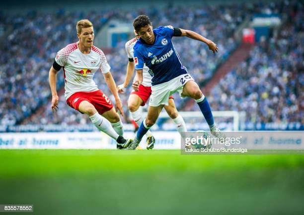 Amine Harit of Schalke and Marcel Halstenberg of Leipzig fight for the ball during the Bundesliga match between FC Schalke 04 and RB Leipzig at...