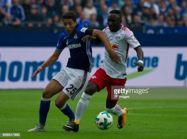 Amine Harit of Schalke and Naby Keita of Leipzig battle for the ball during the Bundesliga match between FC Schalke 04 and RB Leipzig at VeltinsArena...