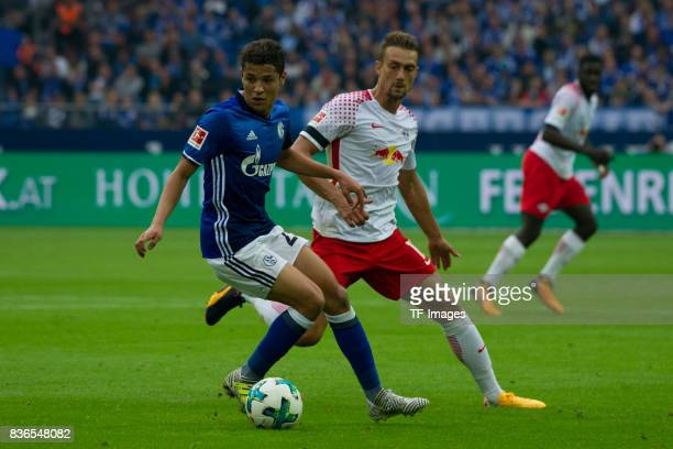 Amine Harit of Schalke and Stefan Ilsanker of Leipzig battle for the ball during the Bundesliga match between FC Schalke 04 and RB Leipzig at...