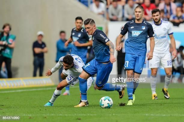 Amine Harit of Schalke and Steven Zuber of Hoffenheim battle for the ball during the Bundesliga match between TSG 1899 Hoffenheim and FC Schalke 04...