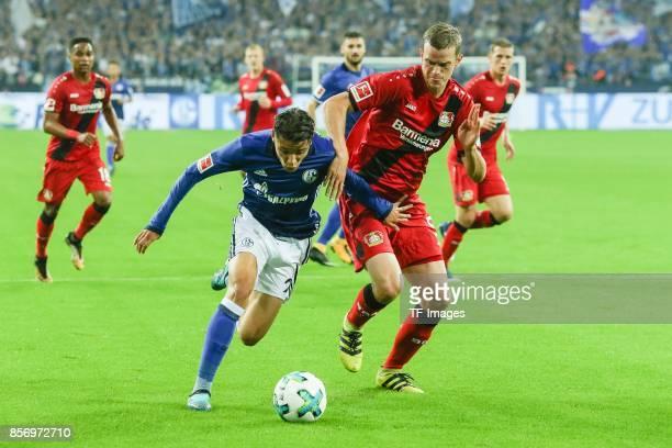 Amine Harit of Schalke and Sven Bender of Leverkusen battle for the ball during the Bundesliga match between FC Schalke 04 and Bayer 04 Leverkusen at...