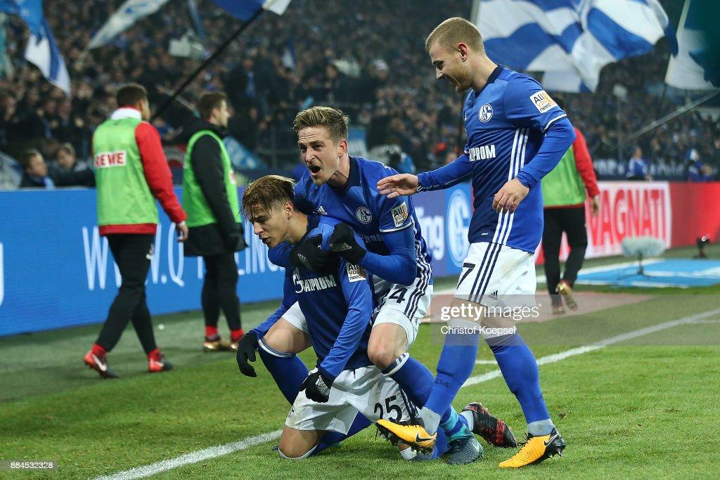 Amine Harit of Schalke (l) celebrates after he scored a goal to make it 2:1 during the Bundesliga match between FC Schalke 04 and 1. FC Koeln at Veltins-Arena on December 2, 2017 in Gelsenkirchen, Germany.
