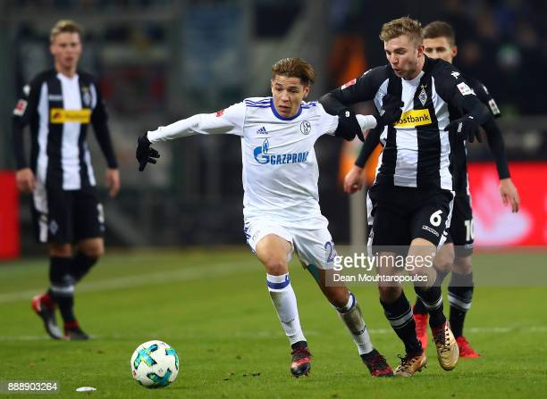 Amine Harit of Schalke fights for the ball with Christoph Kramer of Moenchengladbach during the Bundesliga match between Borussia Moenchengladbach...