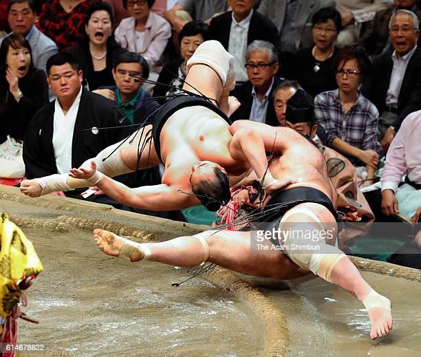 Aminishiki throws Egyptian wrestler Osunaarashi during day fourteen of the Grand Sumo Autumn Tournament at Ryogoku Kokugikan on September 24 2016 in...