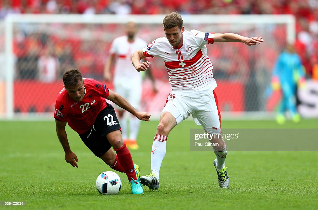 Amir Abrashi of Albania and <a gi-track='captionPersonalityLinkClicked' href=/galleries/search?phrase=Fabian+Frei&family=editorial&specificpeople=4783637 ng-click='$event.stopPropagation()'>Fabian Frei</a> of Switzerland compete for the ball during the UEFA EURO 2016 Group A match between Albania and Switzerland at Stade Bollaert-Delelis on June 11, 2016 in Lens, France.