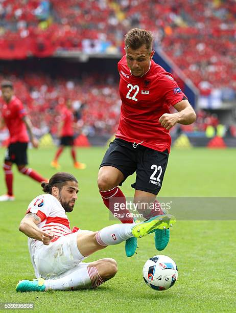 Amir Abrashi of Albania is tackled by Ricardo Rodriguez of Switzerland during the UEFA EURO 2016 Group A match between Albania and Switzerland at...