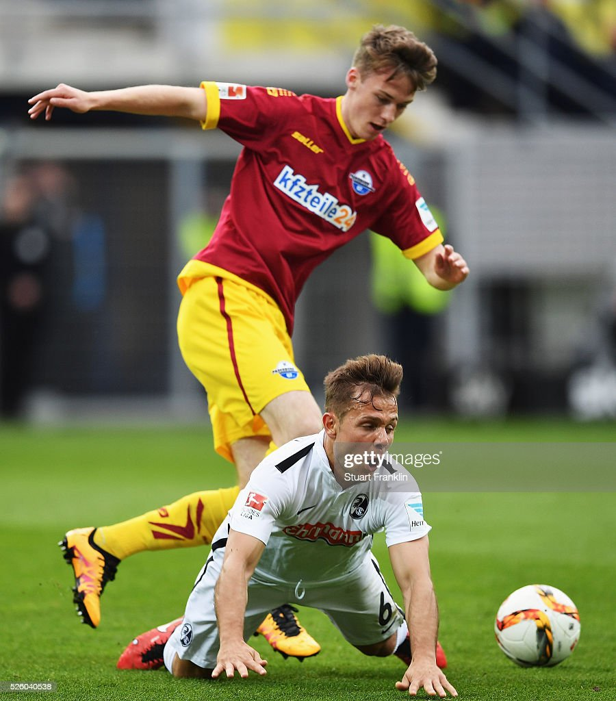 Amir Abrashi of Freiburg is challenged by Sebastian Schonlau of Paderborn during the second Bundesliga match between SC Paderborn and SC Freiburg at the Benteler Arena on April 29, 2016 in Paderborn, North Rhine-Westphalia.