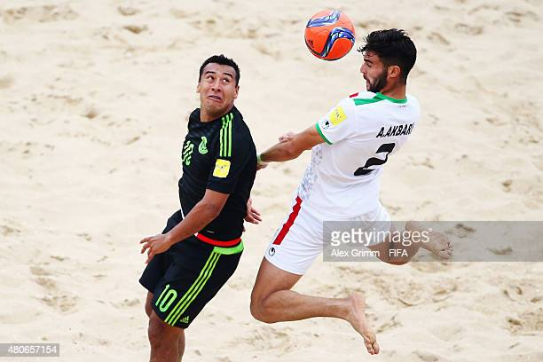 Amir Akrabi of Iran is challenged by Abdiel Villa of Mexico during the FIFA Beach Soccer World Cup Portugal 2015 Group C match between Mexico and...