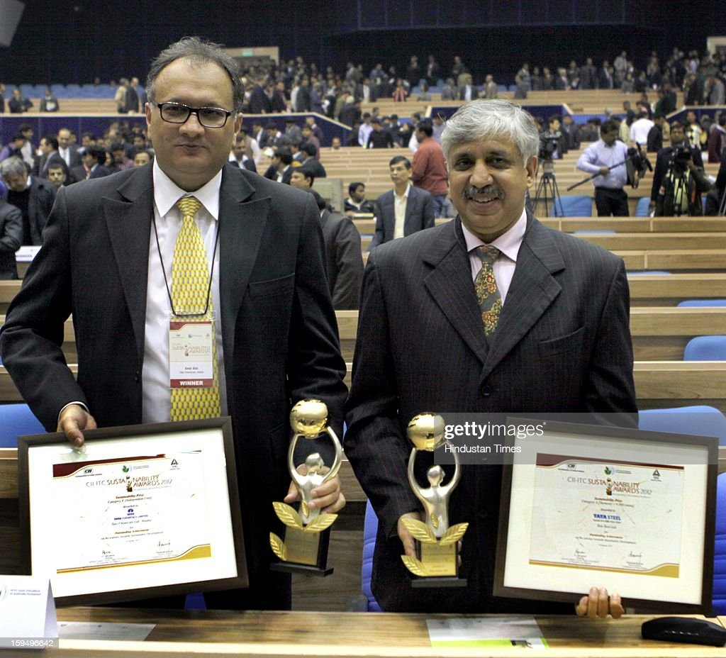Amir Alvi (Vice President TATA Chemicals Ltd and Chanakya Chaudhary Chief Resident Executive TATA Steel, Delhi with their Awards presented by President Pranab Mukharjee at Vigyan Bhawan on January 14, 2013 in New Delhi, India.