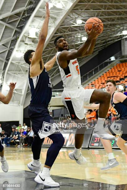 Amir Bell of the Princeton Tigers attempts to score on Yoeli Childs of the Brigham Young Cougars during the second half at L Stockwell Jadwin...