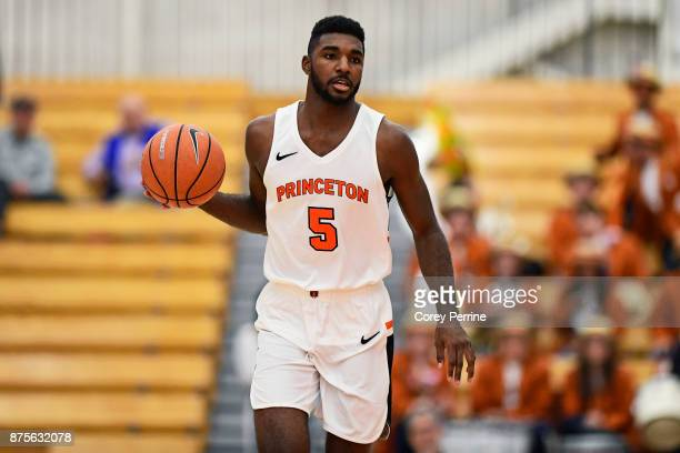 Amir Bell of the Princeton Tigers handles the ball against the Brigham Young Cougars during the second half at L Stockwell Jadwin Gymnasium on...