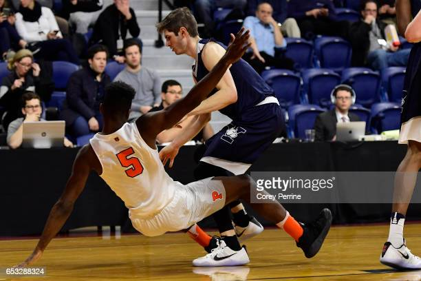 Amir Bell of the Princeton Tigers is fouled by Anthony Dallier of the Yale Bulldogs during the first half of the Ivy League tournament final at The...