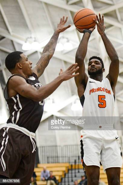 Amir Bell of the Princeton Tigers shoots against Lance Tejada of the Lehigh Mountain Hawks during the first half at L Stockwell Jadwin Gymnasium on...