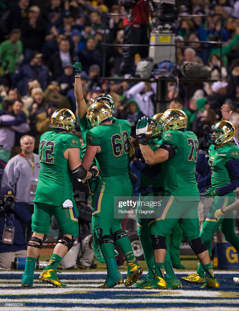 Amir Carlisle #3 of the Notre Dame Fighting Irish celebrates his touchdown against the Boston College Eagles with his teammates Nick Martin #72, Mike McGlinchey #68, Steve Elmer #79 and Will Fuller #7 at Fenway Park during the 'Shamrock Series' on November 21, 2015 in Boston, Massachusetts. The Fighting Irish won 19-16.