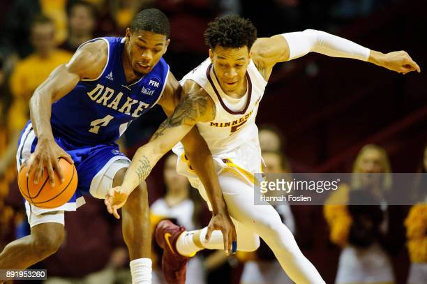 Amir Coffey of the Minnesota Golden Gophers knocks the ball away from De'Antae McMurray of the Drake Bulldogs during the game on December 11 2017 at...