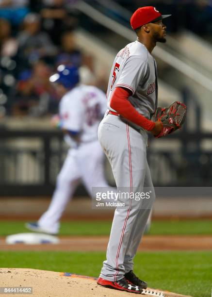 Amir Garrett of the Cincinnati Reds looks on after surrendering a second inning home run against Travis Taijeron of the New York Mets at Citi Field...