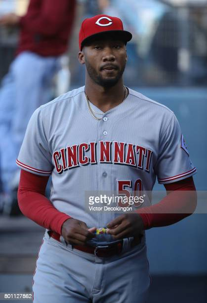 Amir Garrett of the Cincinnati Reds walks in the dugout prior to the MLB game against the Los Angeles Dodgers at Dodger Stadium on June 9 2017 in Los...