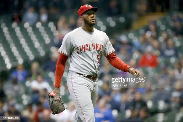 Amir Garrett of the Cincinnati Reds walks off the field after being relieved in the fourth inning against the Milwaukee Brewers at Miller Park on...