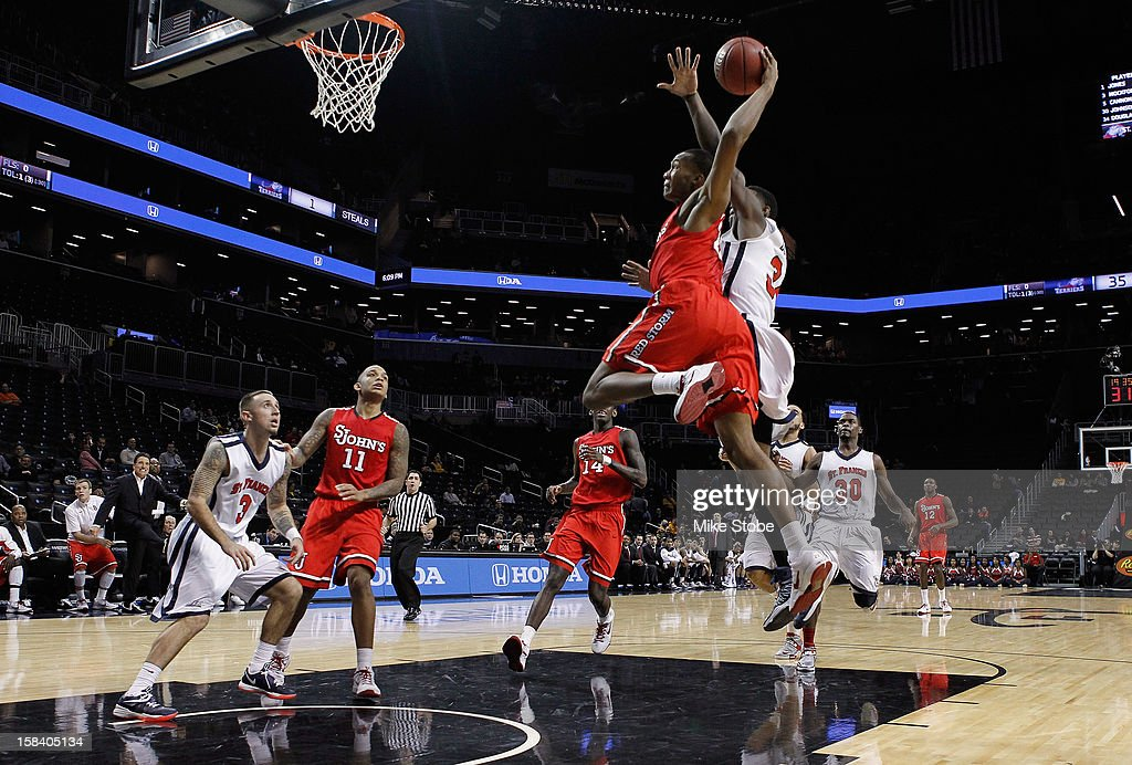 Amir Garrett #22 of the St. John's Red Storm drives to the net against St. Francis Terriers during the Brooklyn Hoops Winter Festival on December 15, 2012 at Barclays Center in the Brooklyn borough of New York City. St. John's Red Storm defeated St. Francis (Ny) Terriers 77-60.