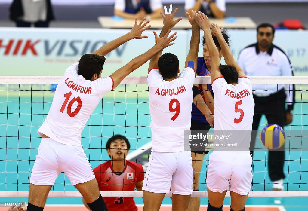 Amir Ghafour (L) and Adel Gholami and Farhad Ghaemi during 17th Asian Men's Volleyball Championship between Iran And Japan on October 5, 2013 in Dubai, United Arab Emirates.