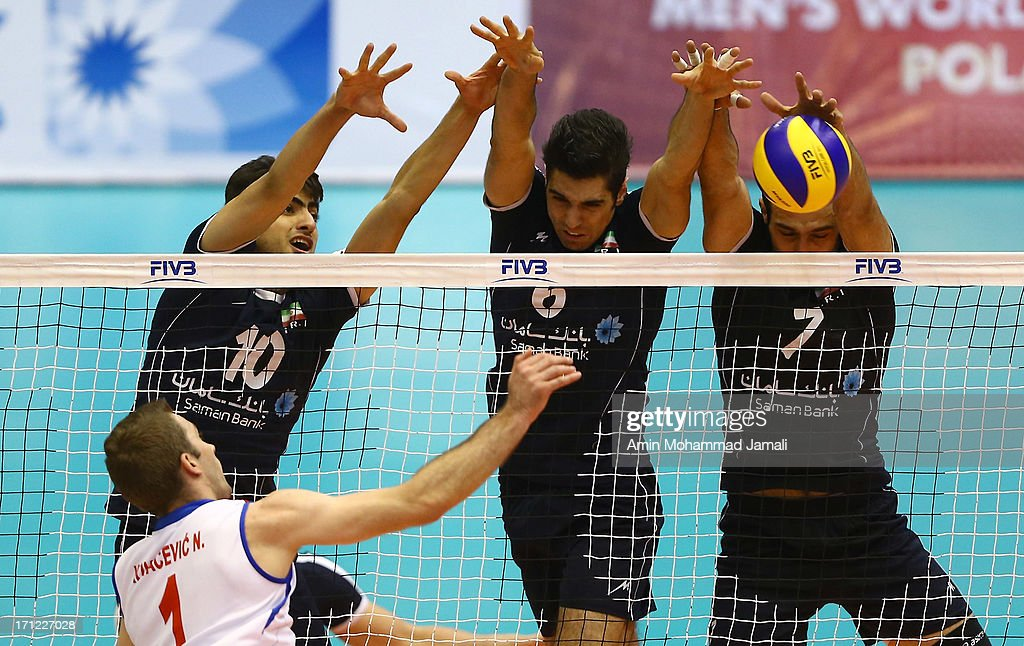 Amir Ghafour (L) and Seyed Mohammad Mousavi Eraghi and Hamzeh Zarini of Iran during Volleyball World League between Iran v Serbia on June 23, 2013 in Tehran, Iran Azadi Complex.