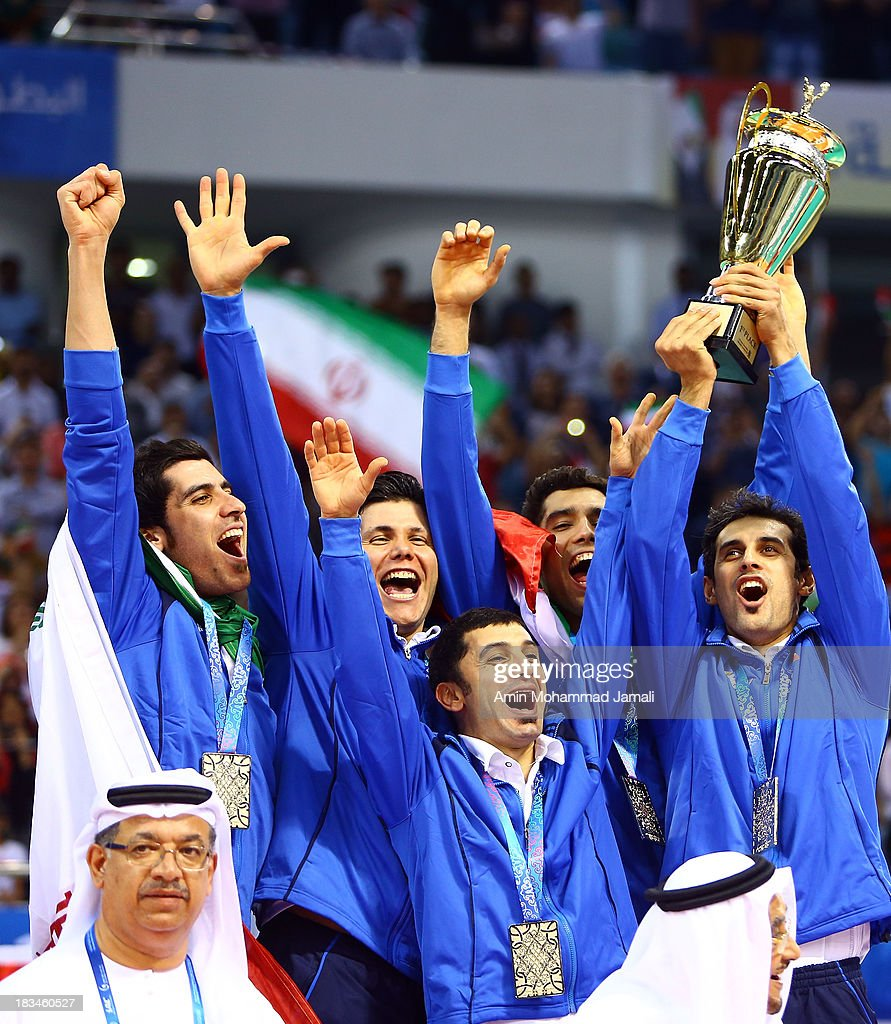 Amir Ghafour and Shahram Mahmoudi and Mehdi Mahdavi and Farhad Zarif and Seyed Mohammad Mousavi and Mir saeed Marouf in clebration during 17th Asian Men's Volleyball Championship between Iran And Korea on October 6, 2013 in Dubai, United Arab Emirates.