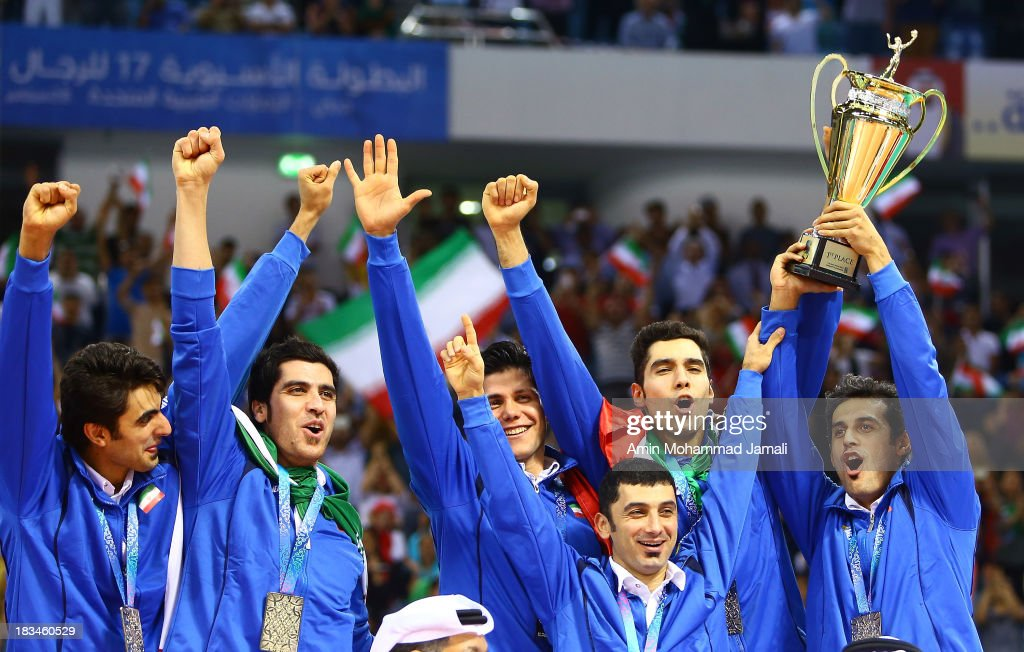 Amir Ghafour and Shahram Mahmoudi and Mehdi Mahdavi and Farhad Zarif and Seyed Mohammad Mousavi and Mir saeed Marouf in celebration during 17th Asian Men's Volleyball Championship between Iran And Korea on October 6, 2013 in Dubai, United Arab Emirates.