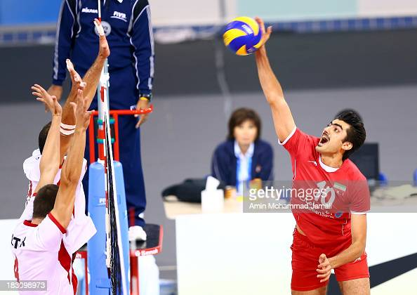 Amir Ghafour of Iran spikes the ball during 17th Asian Men's Volleyball Championship between Iran And Lebanon on October 4 2013 in Dubai United Arab...