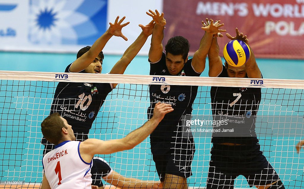 Amir Ghafour, Seyed Mohammad Mousavi Eraghi and Hamzeh Zarini of Iran during the FIVB Volleyball World League match between Iran and Serbia at the Iran Azadi Complex on June 23, 2013 in Tehran, Iran.