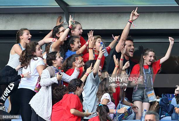 Amir Haddad sings and poses for photos with fans during the UEFA Euro 2016 round of 16 match between Italy and Spain at Stade de France on June 27...