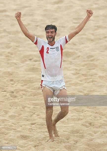 Amir Hosein Akbari Fartkhouni of Iran celebrates winning the Men's Beach Soccer gold medal match between Iran and Japan during the 2014 Asian Beach...