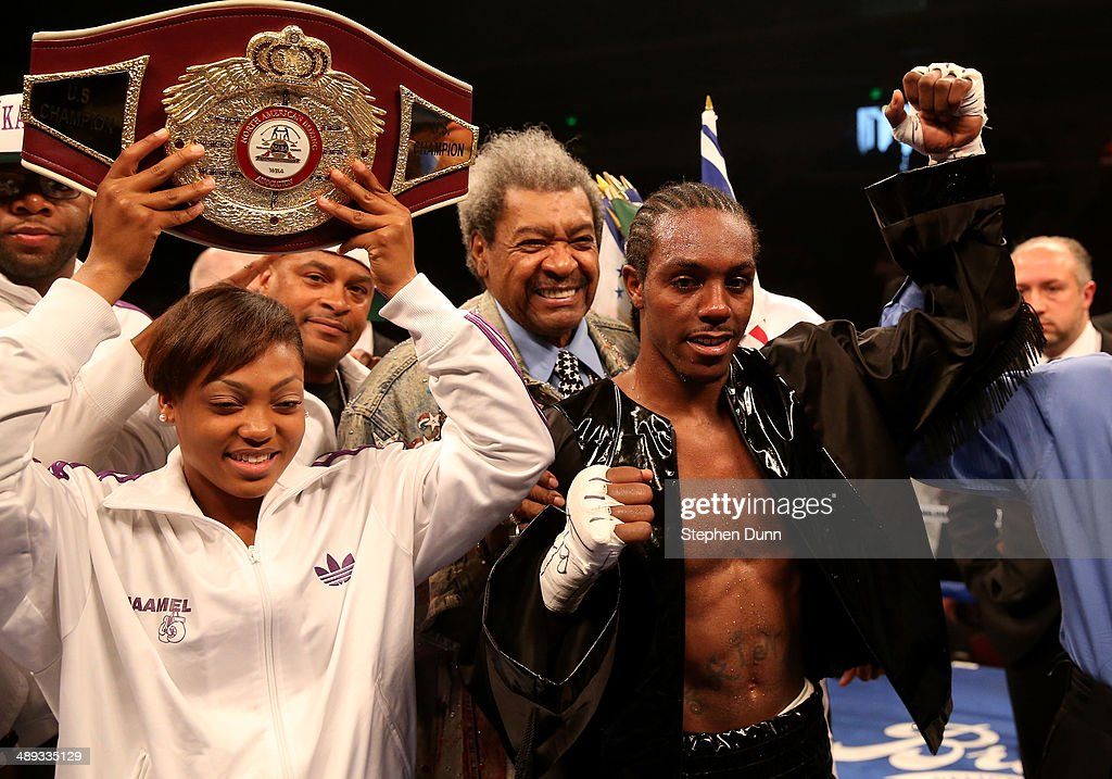 Amir Imam celebrates with Don King (C) after defeating Yordens Ugas in their super lightweight match at Galen Center on May 10, 2014 in Los Angeles, California. Stiverne won in a six round technical knockout.