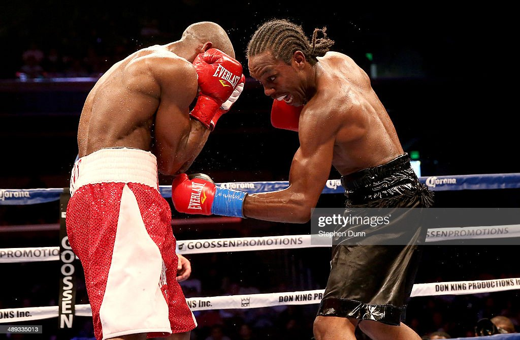 Amir Imam (R) throws a punch at Yordens Ugas in their super lightweight match at Galen Center on May 10, 2014 in Los Angeles, California. Stiverne won in a six round technical knockout.