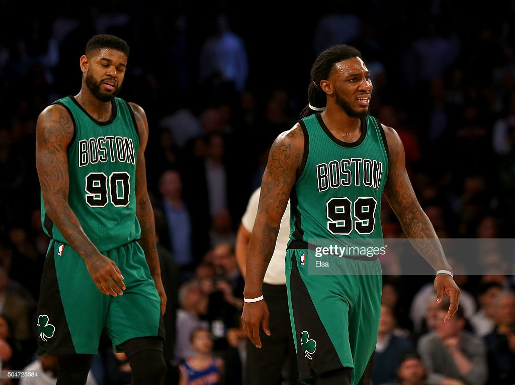 Amir Johnson #90 and Jae Crowder #99 of the Boston Celtics react to the loss to the New York Knicks at Madison Square Garden on January 12, 2016 in New York City.The New York Knicks defeated the Boston Celtics 120-114.